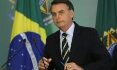 O presidente Jair Bolsonaro durante a cerimônia de assinatura do decreto que facilita a posse de armas no Brasil Foto: Jorge William / Agência O Globo