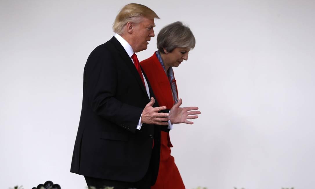 May e Trump: nenhum dos dois irá ao Fórum Econômico Mundial Foto: Pablo Martinez Monsivais / AP