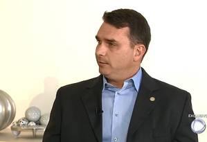O deputado estadual e senador eleito Flávio Bolsonaro, durante entrevista à 'Record' Foto: Reprodução