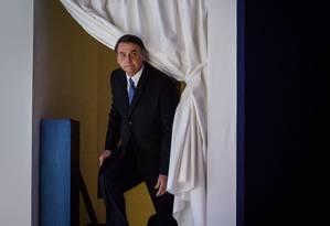 Presidente Jair Bolsonaro sobe ao palco para discursar em Davos Foto: FABRICE COFFRINI / AFP