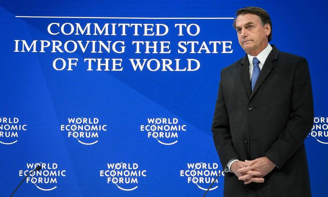 Bolsonaro aguarda ser chamado para proferir seu discurso na abertura do Fórum Econômico Mundial Foto: FABRICE COFFRINI / AFP