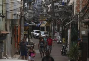 A rotina na Rua Nova, uma das principais da comunidade de Rio das Pedras, mudou pouco na manhã seguinte à ação contra a milícia Foto: fabiano rocha / Agência O Globo