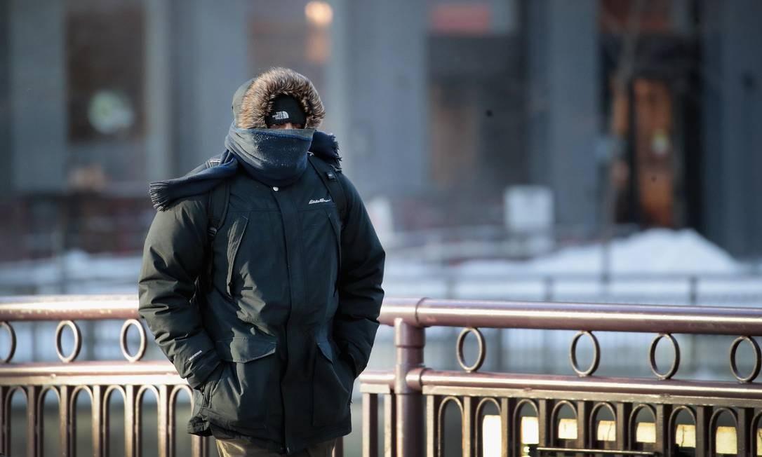 Em Chigago, as temperaturas despencaram e estão abaixo de zero desde o início da manhã de ontem Foto: SCOTT OLSON / AFP