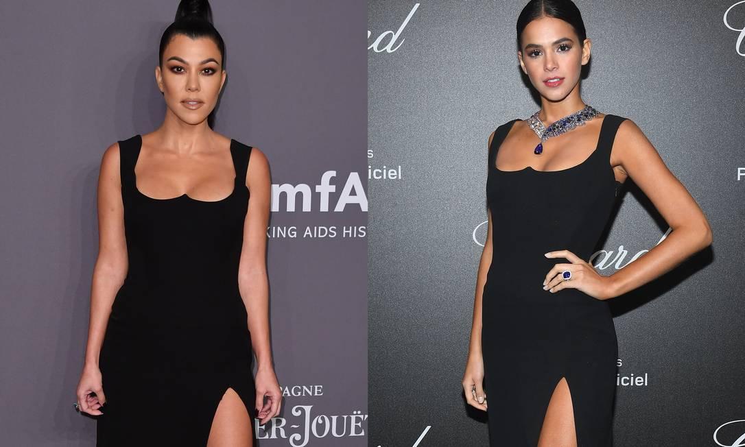 Kourtney Kardashian parou o tapete vermelho do baile beneficente da amfAR, em Nova Yoek, nesta quarta-feira, com um vestidinho preto Versace. Uma olhada mais atenta, revela que o look é um velho conhecido da turma da moda e dos brasileiros. No ano passado, Bruna Marquezine usou a peça em Cannes Foto: ANGELA WEISS / AFP e Getty Images