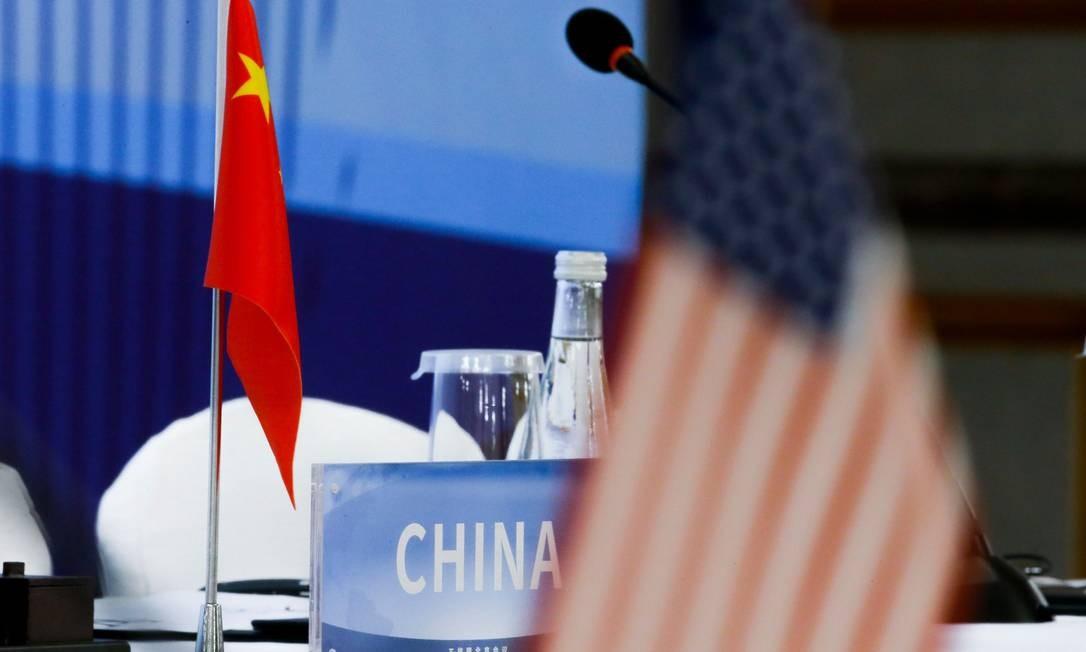 Negociadores americanos estão em Pequim para tentar um acordo com os chineses Foto: THOMAS PETER / AFP