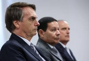O presidente Jair Bolsonaro, o vice Hamilton Mourão e o ministro da Casa Civil Onyx Lorenzoni Foto: Marcos Corrêa / PR