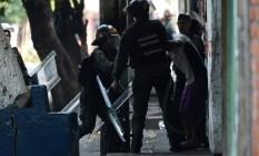 Membros da Guarda Nacional detêm manifestante Foto: JUAN BARRETO / AFP