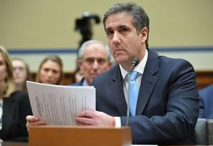 Michael Cohen, ex-advogado pessoal de Trump, fala durante abertura de audiência na Câmara dos Representantes dos EUA Foto: MANDEL NGAN / AFP