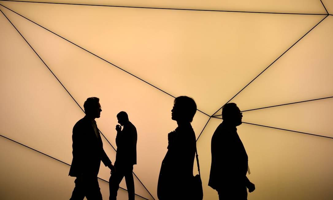 Visitantes do Mobile World Congress, feira de tecnologia em Barcelona: internet chega ao corpo Foto: Gabriel Bouys / AFP