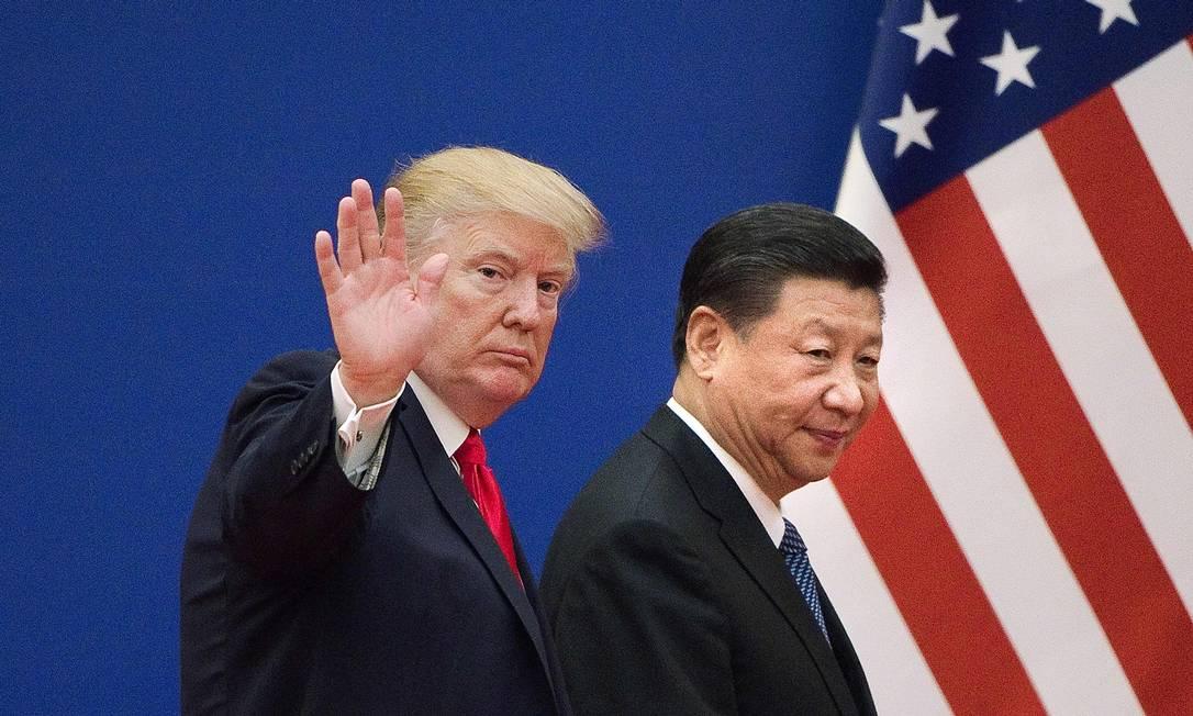 Presidentes Trump e Xi Jinping costuram um novo entendimento Foto: NICOLAS ASFOURI / AFP