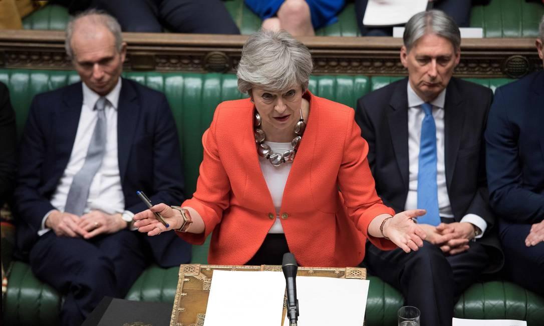 A primeira-ministra britânica Theresa May falando no início do debate sobre a segunda votação do acordo do Brexit, na Câmara dos Comuns em Londres Foto: JESSICA TAYLOR / AFP