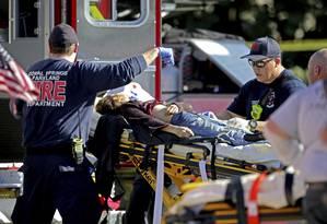 Após massacre em escola de Parkland,na Flórida, americanos protestaram para pedir restrições às armas Foto: John McCall / AP