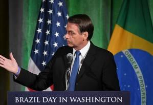 O presidente Jair Bolsonaro discursa na Câmara de Comércio, em Washington Foto: MANDEL NGAN / AFP