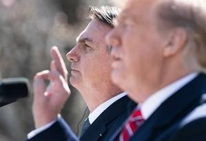 Trump e Bolsonaro na Casa Branca: Venezuela fez parte da pauta da reunião Foto: BRENDAN SMIALOWSKI / AFP
