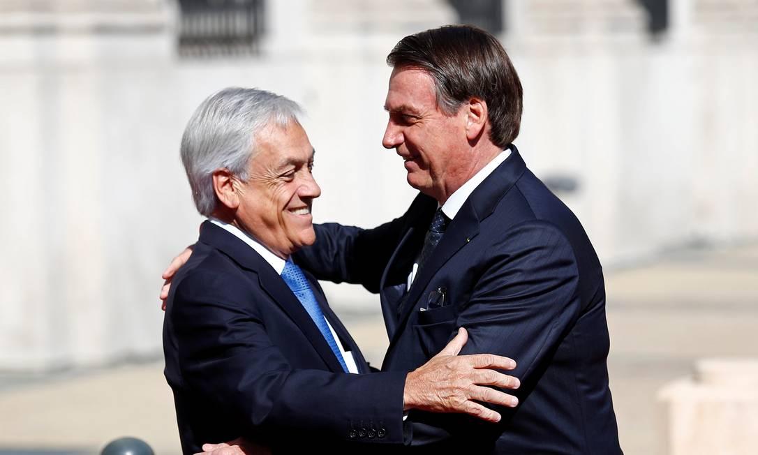 Os presidentes Sebastián Piñera e Jair Bolsonaro durante encontro em Santiago, capital do Chile Foto: Esteban Garay / Reuters