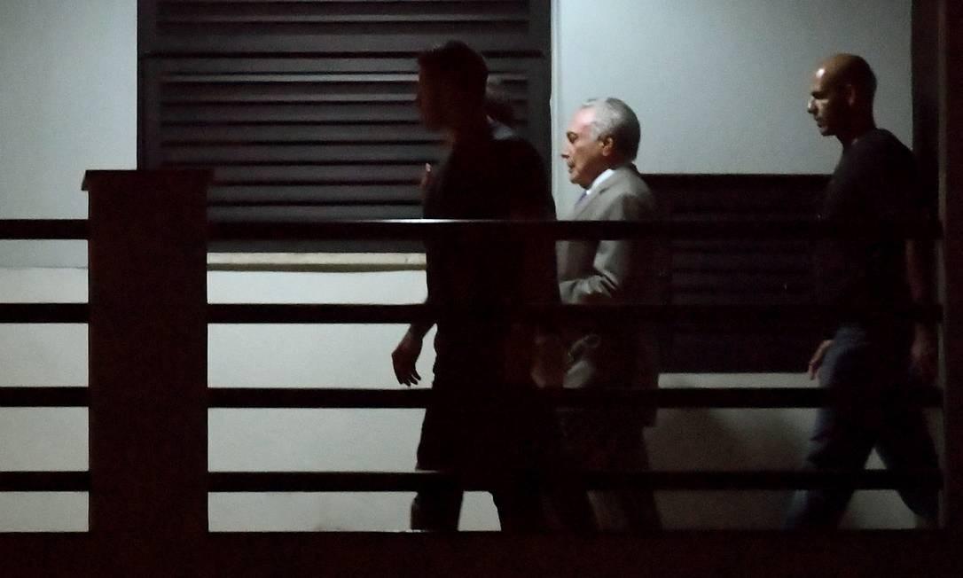 Temer chega escoltado à sede da Polícia Federal no Rio de Janeiro Foto: Mauro Pimentel / AFP