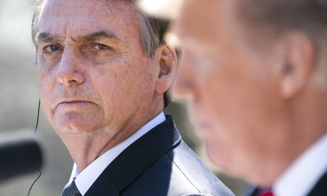 O presidente Jair Bolsonaro em encontro com o presidente dos EUA Donald Trump, em Washington Foto: Jim Lo-Scalzo Pool / Getty Images