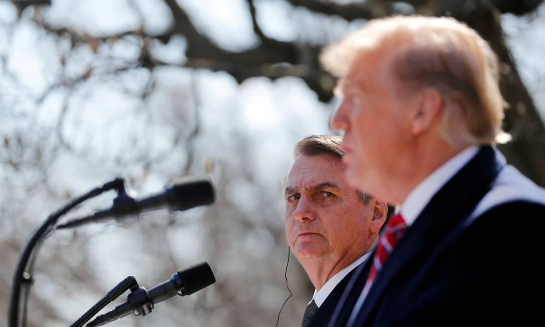 Bolsonaro e Trump: EUA apoiam entrada do Brasil na OCDE em troca da retirada do status de emergente na OMC. Foto: Carlos Barria / REUTERS