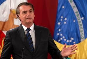 Após voltar do Chile, Bolsonaro recebeu líder do PSL na Câmara para tratar de Previdência Foto: Claudio Reyes / AFP