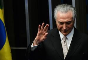 Temer mostrava-se ofendido sempre que o questionavam se renunciaria; tal qual um homem honesto. Foto: Andressa Anholete / AFP