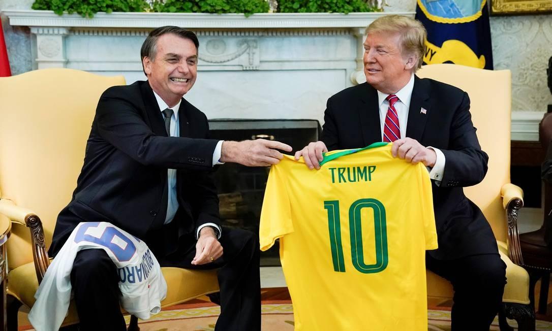 Ainda em março, Bolsonaro foi aos EUA para se aproximar de Donald Trump; tratava-se da primeira visita oficial do novo presidente Foto: Kevin Lamarque / Reuters