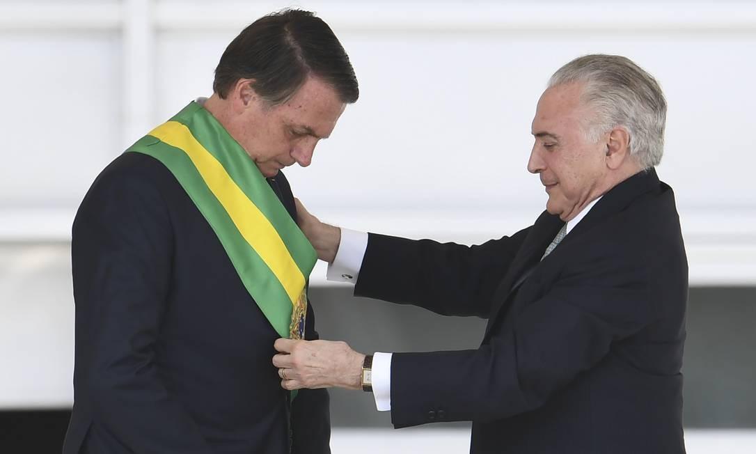 Após ser eleito com 57.797.847 votos, Jair Bolsonaro recebeu a faixa presidencial de Michel Temer em 1º de janeiro Foto: Evaristo Sá / AFP