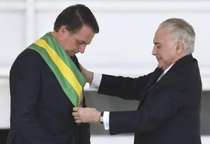 Após ser eleito com 57.797.847 de votos, Jair Bolsonaro recebeu a faixa presidencial de Michel Temer 01/01/2019 Foto: EVARISTO SA / AFP