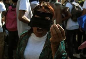 Manifestante mostra bala durante confrontos em protesto contra governo de Daniel Ortega em Manágua Foto: MAYNOR VALENZUELA / AFP/30-03-2019