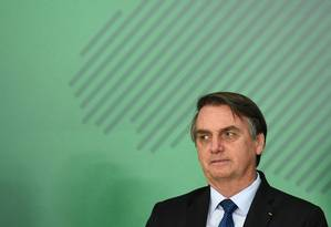 O presidente Jair Bolsonaro durante solenidade no Palácio do Planalto Foto: Evaristo Sa / AFP