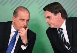 Em reunião com chefe da Casa Civil, Onyx Lorenzoni, Bolsonaro tomou a decisão de vetar o aumento do diesel Foto: EVARISTO SA / EVARISTO SA/AFP/09-04-2019