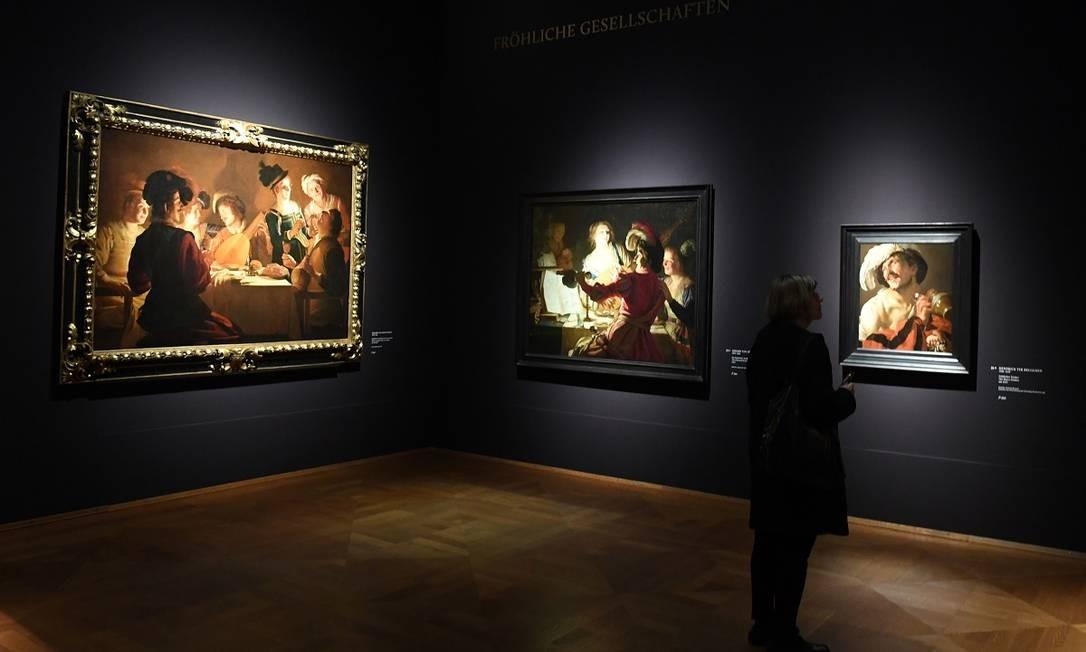 A exposição reúne mais de 70 pinturas de Caravaggio e outros artistas inspirados por ele, como o espanhol Josepe de Ribera, o italiano Bartolomeo Manfredi e o holandês Gerard van Honthorst Foto: CHRISTOF STACHE / AFP
