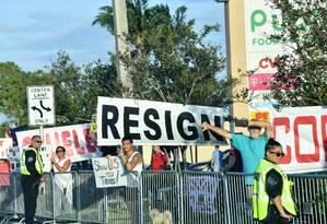 Manifestantes protestam contra Donald Trump após divulgação de relatório sobre investigação envolvendo sua campanha e Rússia Foto: NICHOLAS KAMM / AFP