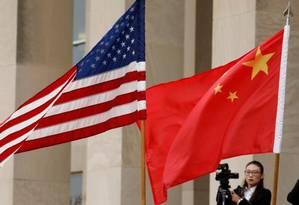 Guerra comercial de vários meses entre os dois países desacelerou o crescimento global e afetou os mercados Foto: Reuters
