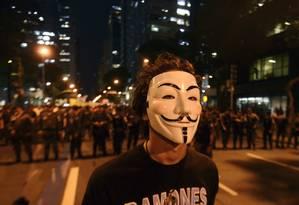 A imagem de Guy Fawkes, conservador católico que queria explodir o Parlamento britânico e matar o rei, virou símbolo anarquista Foto: Lucas Landau / Agência O Globo