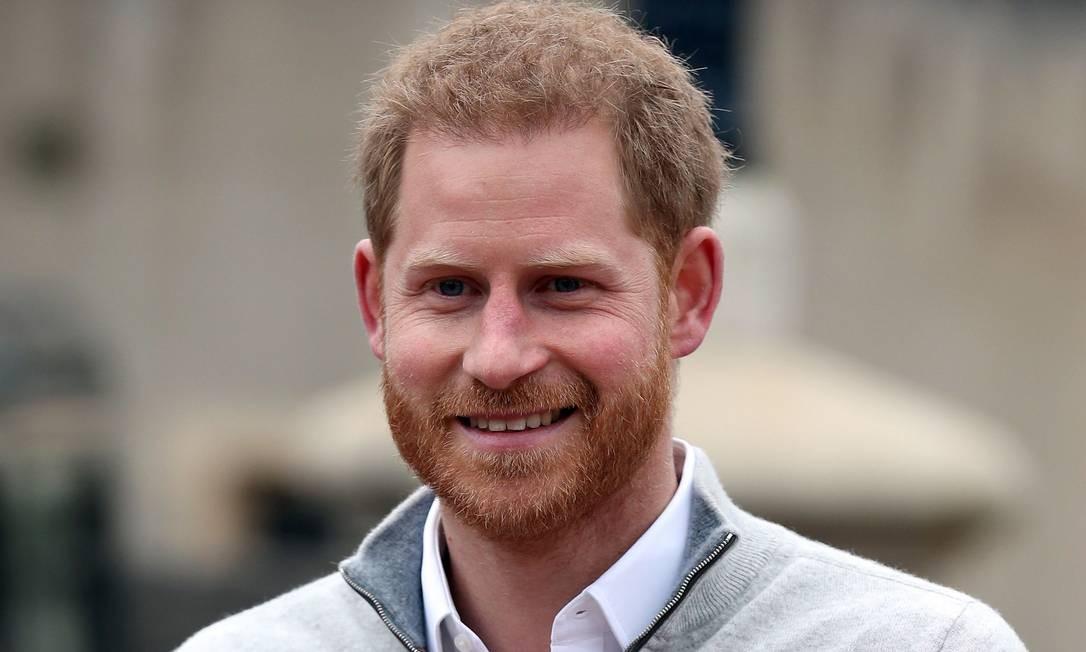 """""""Estamos muito felizes em anunciar que Meghan e eu tivemos um bebê menino nesta manhã — um menino muito saudável"""", disse o príncipe Harry. Foto: STEVE PARSONS / AFP"""