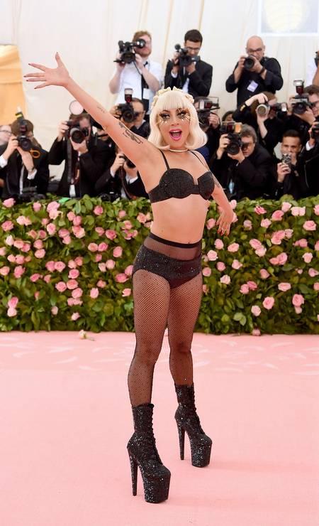 No final, ela ficou de lingerie preta brilhante, com botas de saltos gigantescos Foto: Jamie McCarthy/AFP