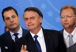 Bolsonaro durante a assinatura do decreto que alterou regras para o porte de armas Foto: Adriano Machado / Reuters