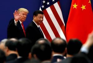 Os presidentes dos EUA, Donald Trump, e da China, Xi Jinping, durante encontro realizado em Pequim Foto: Damir Sagolj / REUTERS
