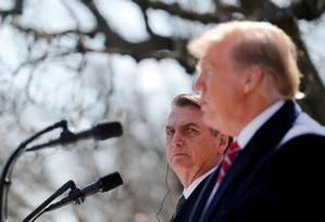 Bolsonaro com Trump no jardim da Casa Branca durante a visita de março passado: ex-presidente Bush é um dos mais fortes críticos do atual mandatário americano entre conservadores Foto: Carlos Barria/Reuters/19-03-2019