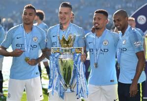 Danilo, Ederson, Gabriel Jesus e Fernandinho: os brasileiros do City Foto: GLYN KIRK / AFP