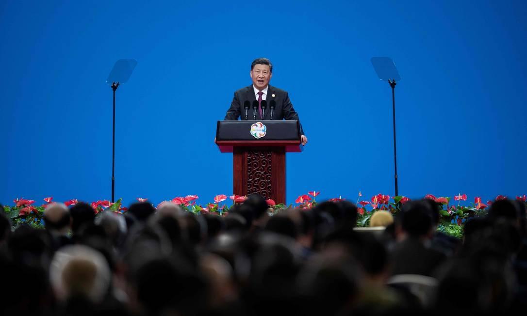 O presidente chinês, Xi Jinping, discursa durante a cerimônia de abertura da Conferência sobre Diálogo de Civilizações Asiáticas no Centro Nacional de Convenções, em Pequim Foto: NICOLAS ASFOURI / AFP