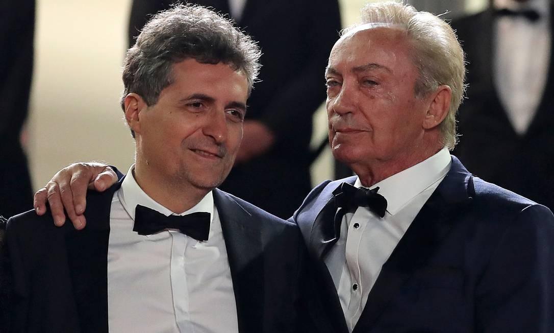 O diretor Kleber Mendonca Filho com o ator alemão Udo Kier Foto: VALERY HACHE / AFP