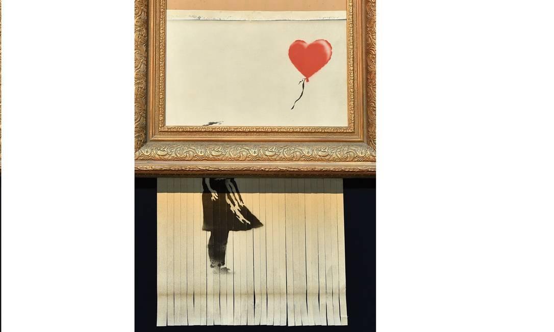 Obra 'Menina com balão', de Banksy Foto: BEN STANSALL / AFP