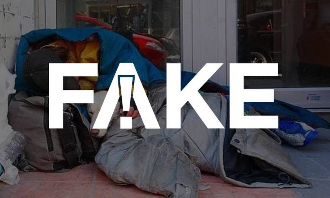 É #FAKE que foto mostre morador de rua e seu cachorro mortos de frio no Brasil Foto: Reprodução