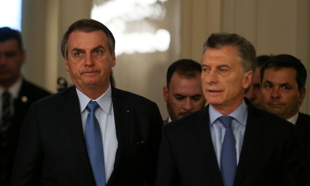 Jair Bolsonaro e Mauricio Macri chegam para encontro na Casa Rosada Foto: AGUSTIN MARCARIAN / REUTERS
