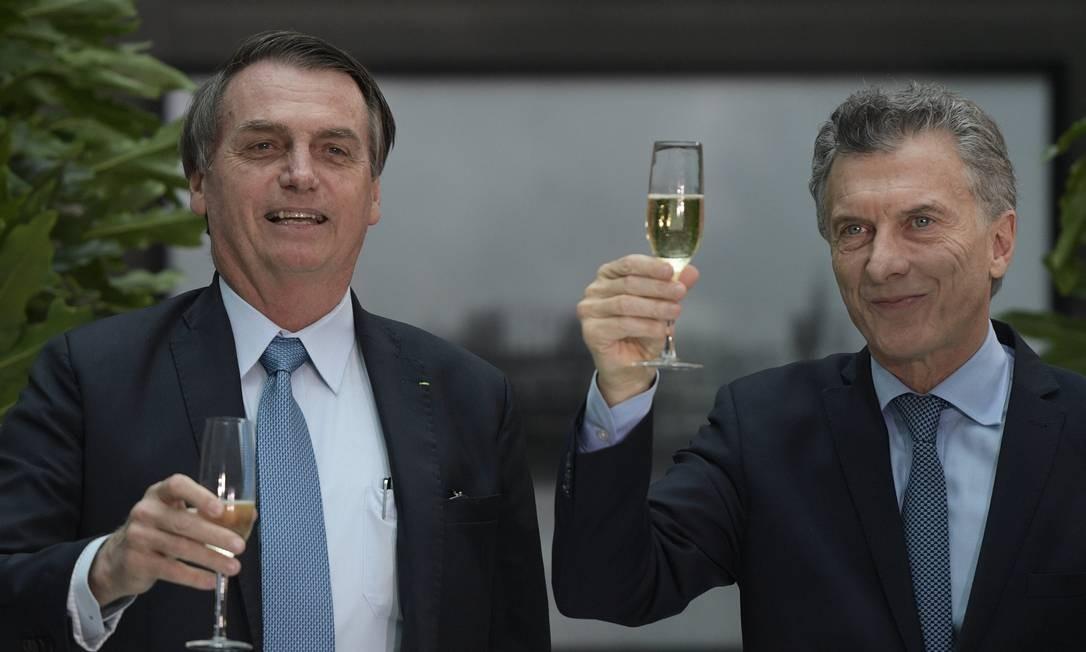 O presidente brasileiro Jair Bolsonaro e o argentino Mauricio Macri Foto: JUAN MABROMATA / AFP