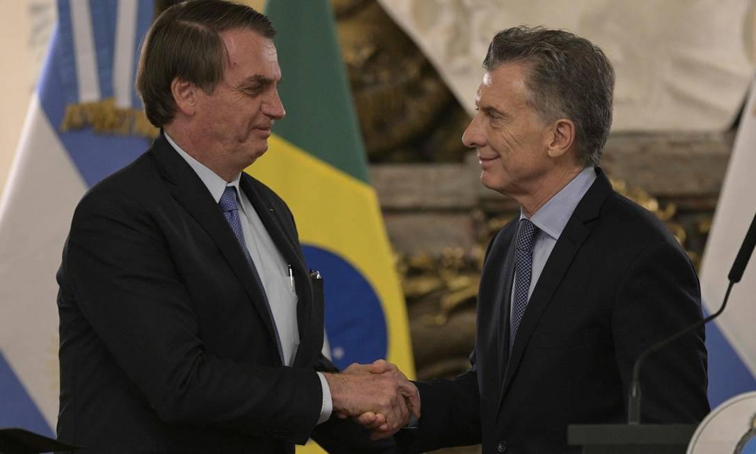 Jair Bolsonaro se encontrou com o presidente argentino Mauricio Macri: moeda única estaria em estudo, disse o presidente brasileiro Foto: JUAN MABROMATA/AFP/06-06-2019