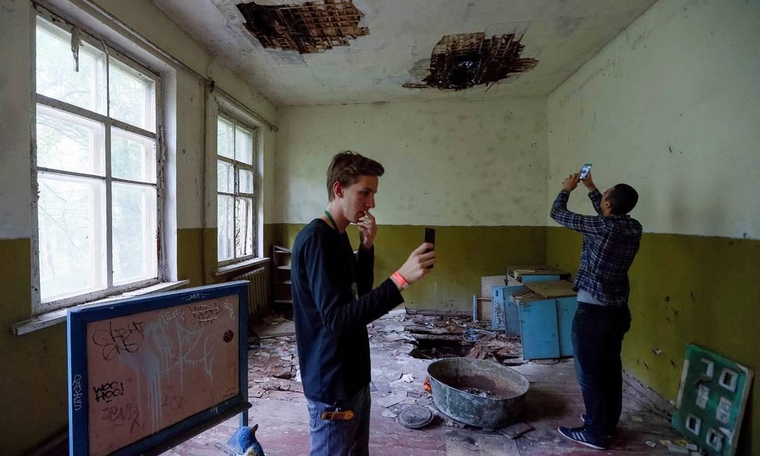 Prédios abandonados, como esta creche no vilarejo de Kopachi, perto da usina nuclear de Chernobyl, são alguns dos pontos mais procurados pelos visitantes Foto: VALENTYN OGIRENKO / REUTERS