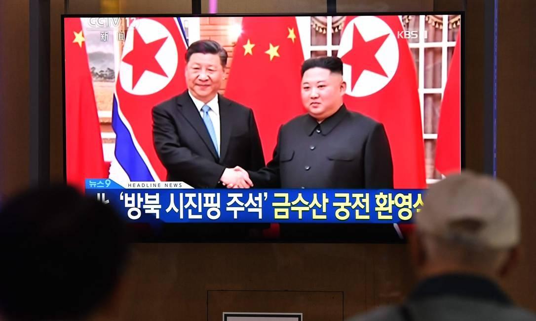 Xi Jinping é o primeiro líder chinês a visitar a Coreia do Norte em 14 anos Foto: JUNG YEON-JE / AFP