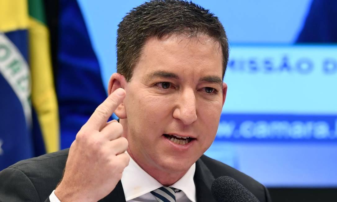 O jornalista Glenn Greenwald participou de sessão da Comissão de Direitos Humanos da Câmara no início da tarde desta terça-feira (25). Ele classificou de chocante o suposto conluio entre o ex-juiz Sergio Moro, hoje ministro da Justiça, e o procurador Deltan Dallagnol em processos da Operação Lava-Jato Foto: EVARISTO SA / AFP